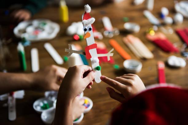 Manualidades ninos navidad muñeco navidad palito helado