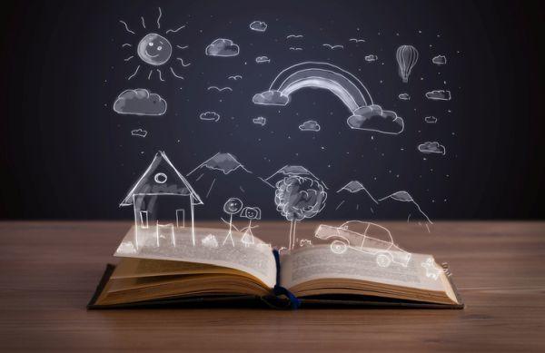 Libro abierto con paisaje dibujado